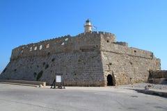 Castle in Mandraki harbour in Rhodes, Greece royalty free stock image