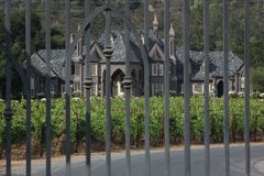 Castle mansion behind iron gate Stock Photo