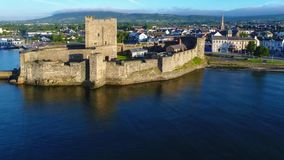 Castle and marina in Carrickfergus near Belfast, Northern Ireland stock footage