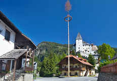Castle in Mauterndorf, at the forefront of traditional wooden ho Royalty Free Stock Photos