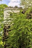 Castle merlons behind trees Stock Photo