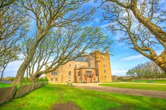 Castle of Mey forest. In front of main doorway of Barrogill castle located in the Highlands of Scotland, United Kingdom. Popular landmark and famous touristic royalty free stock photos