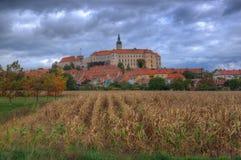 Castle Mikulov, Moravia, Czech Republic. Autumn picture. Amazing landscape with medieval castle and dramatic cloudy sky Stock Photos