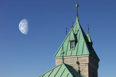 Castle Moon. The moon shines over a gothic castle tower stock photo