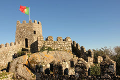 Castle of the Moors. Portuguese flag on a tower. Sintra. Portugal. View of the ruined Castelo dos Mouros (Castle of the Moors) . The castle was constructed Royalty Free Stock Images