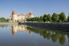 Castle Moritzburg in Saxony near Dresden in Germany surrounded by pond, reflection blue lake, blue sky royalty free stock photo
