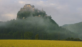 Castle in Morning Mist Stock Image