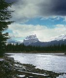 Castle Mountain Alberta Canada. Clearing storm leaves new snow in the Bow River valley and on Castle Mountain, Banff National Park, Canada. Drum scanned 6x9 film stock photography