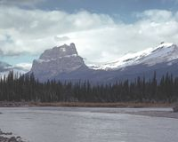 Castle Mountain Banff Alberta Canada. First snow on Castle Mountain, Banff National Park, Canada. Bow river is in the foreground royalty free stock photography