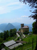Castle on mountain top. Castle like building on mountain top village, in the Swiss Alps, with Lake Lugano as a background royalty free stock photography