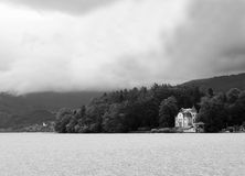Castle near the lake. A photo of a castle near a lake in the mountains (alps royalty free stock photos