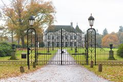 Castle in the netherlands. DENEKAMP, NETHERLANDS - NOVEMBER 2, 2016: Singraven mansion with neoclassical frontage in a rural surrounding Stock Photography