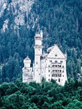 A castle Neuschwanstein in Alps mountains. Royalty Free Stock Photos