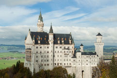 The castle of Neuschwanstein in Bavaria, Germany. Beautiful summer view of the Neuschwanstein castle Royalty Free Stock Photo