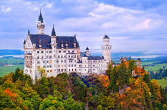 Castle Neuschwanstein in bavarian Alps in early morning light Royalty Free Stock Images