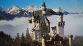 Fairytale castle Neuschwanstein is shrouded in mist royalty free stock images