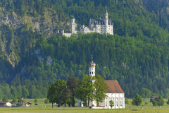 Castle Neuschwanstein and church St. Coloman Royalty Free Stock Photo