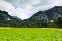 Castle Neuschwanstein and hohenschwangau with alps Stock Images