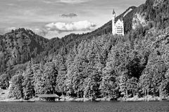 Castle Neuschwanstein at lake black-and-white image Royalty Free Stock Image