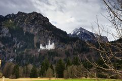 Castle Neuschwanstein landscape of the Alps near town of Fussen Schwarzwald germany. Castle Neuschwanstein and landscape of the Alps mountains near town of royalty free stock photography