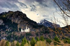 Castle Neuschwanstein landscape of the Alps near town of Fussen Schwarzwald germany. Castle Neuschwanstein and landscape of the Alps mountains near town of royalty free stock images