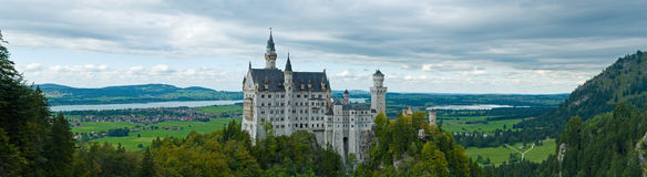 Castle Neuschwanstein with surrounding landscape Royalty Free Stock Photography