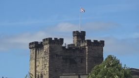 Castle in Newcastle upon Tyne with UK flag. Castle with UK flag- an ancient castle with a UK flag on the top of it, United Kingdom, Newcastle upon Tyne stock footage