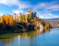 Castle in Niedzica in autumn scenery Stock Photos