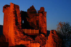 Castle at night. The ruins of the castle at Urquhart at night near Inverness on the banks of Loch Ness in Scotland Royalty Free Stock Photo