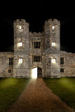Castle at night with door opening Stock Photos