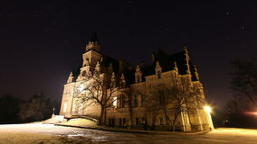 Castle at night with time lapse stars sky stock footage