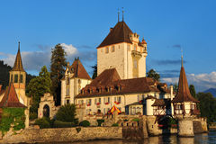 Castle Oberhofen. And Lake Thun on a sunny and warm summer evening, Switzerland Stock Photo