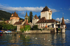 Castle Oberhofen. And Lake Thun on a sunny and warm summer evening, Switzerland Stock Images