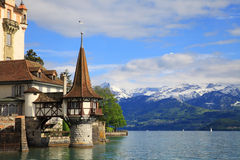 Castle of Oberhofen. With lake of Thun and snowy mountains, Switzerland Stock Photography