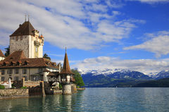 Castle of Oberhofen. With lake of Thun and snowy mountains, Switzerland Royalty Free Stock Photography
