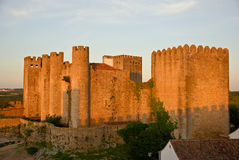 Castle in Obidos. Ancient castle in Obidos, Portugal at sunset Stock Photos