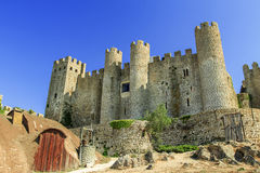 Castle in Obidos, Portugal. One of the most charming Portuguese villages. Old walls, old well creat an atmosphere of old times Royalty Free Stock Photography
