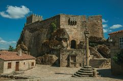 Castle and old houses encircling square with pillory stock image