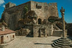 Castle and old houses encircling square with pillory stock images