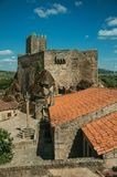 Castle and old houses encircling square with pillory royalty free stock images