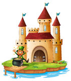A castle with an old man near the pot of gold coins Royalty Free Stock Image