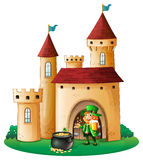 A castle with an old man and a pot of coin Royalty Free Stock Photo