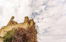 Castle of Olite and clouds bottom view in Navarre, Spain. Worms eye view of impressive Olite castle and clouds in Navarre, Spain Stock Photos