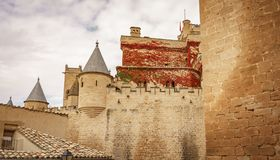 Castle of Olite and clouds, Navarre, Spain. Profile view of impressive Olite castle in Navarre Royalty Free Stock Photos