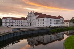 The Castle of Oranienburg and his reflection in the Havel river royalty free stock photos