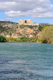 The castle from the other side of the Ebro river, Miravet, Spain Royalty Free Stock Photography