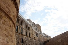 The Castle of Otranto - Corigliano d`Otranto, Apulia, Italy. A Baroque façade built during the 17th century with decorative corbels and anthropomorphic Stock Photos