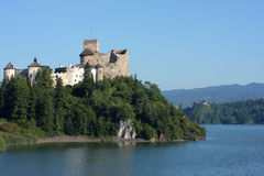 Castle over lake Stock Photos