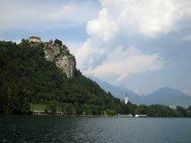Castle over Lake. Photo from the middle of Lake Bled, Slovenia Royalty Free Stock Images