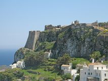 Castle Overlooking the Sea. A castle on the top of the cliff overlooking the sea and having the town beneath, island of Kythira, Greece stock photography